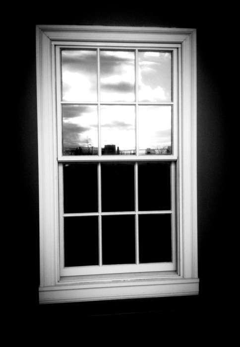 Window to the world: reflection of the setting sun on a window #photo #shotwithiphone