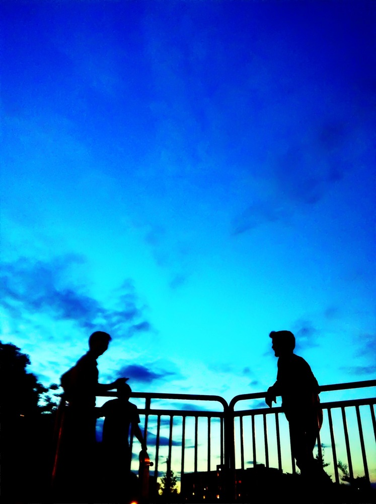 Conversations under a velvety blue sky #photography #iphoneography