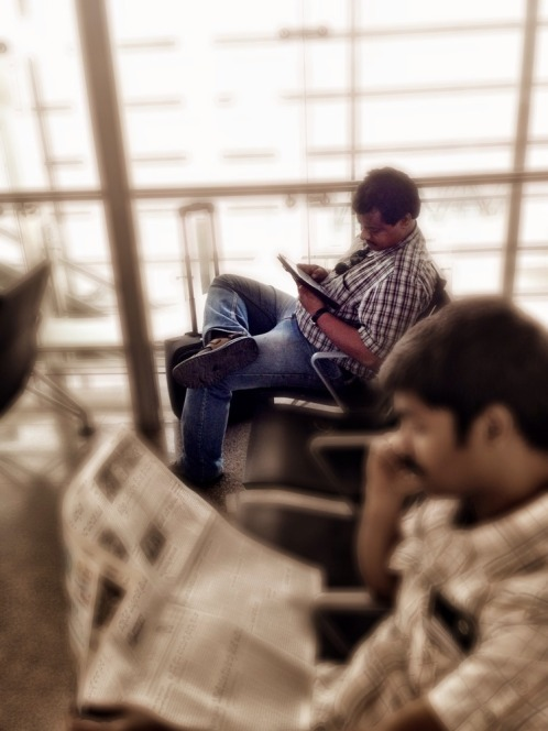 It's the same news, any way you read it on an iPad or on classic newspaper #iphoneography #photography #people
