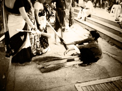Indian street vendor selling indian brooms