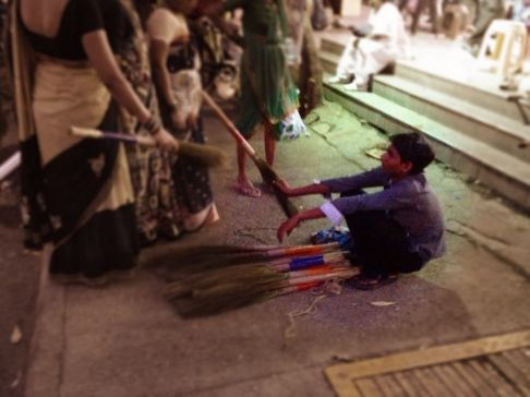 The brooming economy, a person selling broom sticks on the streets of #Mumbai #india #iphoneography #photography