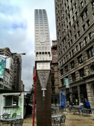 Empire state building rolled up on a fire hose